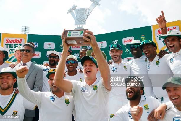 South African team celebrates winning the fifth Test cricket match between South Africa and Australia and the Test Series against Australia for the...