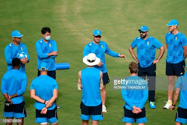 South African team members gather before a practice session at the National Stadium in Karachi on January 23 ahead of their first cricket test match...