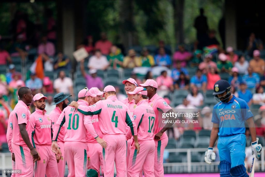 TOPSHOT - South African teammates celebrates the dismissal of Indian batsman Rohit Sharma (R) during the fourth One Day International cricket match between South Africa and India at Wanderers cricket ground on February 10, 2018 in Johannesburg. /