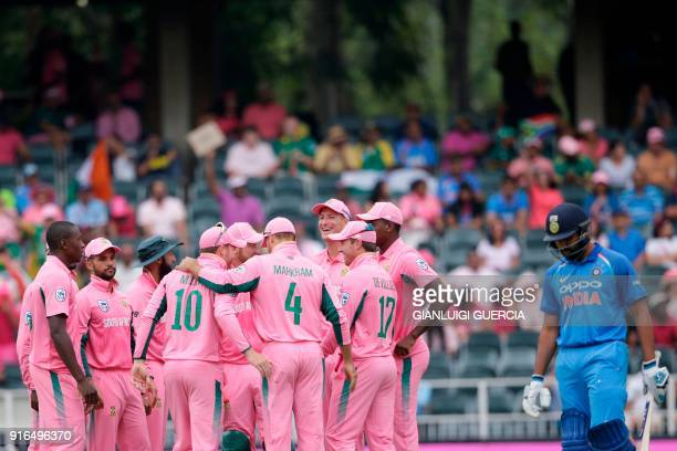 TOPSHOT South African teammates celebrates the dismissal of Indian batsman Rohit Sharma during the fourth One Day International cricket match between...