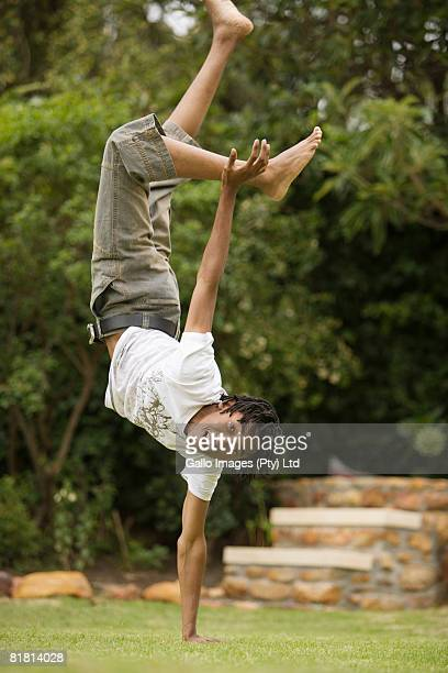South African teen culture - Young male break-dancer balancing on one hand.