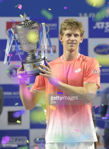 South African tennis player Kevin Anderson holds the trophy after winning the men's single final match for the Tata Open Maharashtra ATP tennis...