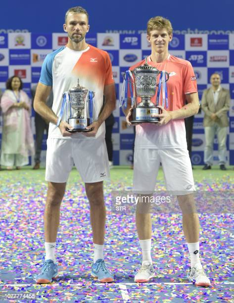 South African tennis player Kevin Anderson poses with the trophy along with Croatioan Ivo Karlovic after winning the men's single final match for the...