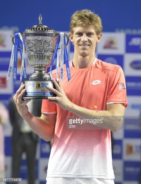 South African tennis player Kevin Anderson poses with the trophy after winning the men's single final match for the Tata Open Maharashtra ATP tennis...