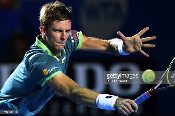 South African tennis player Kevin Anderson returns the ball to South Korea's Hyeon Chung , during their Mexico ATP 500 Open men's single tennis match...