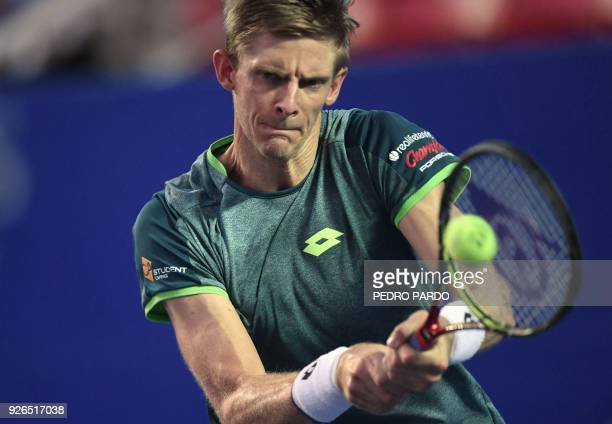 South African tennis player Kevin Anderson returns the ball to US player Jared Donaldson , during their Mexico ATP 500 Open men's single semifinal...