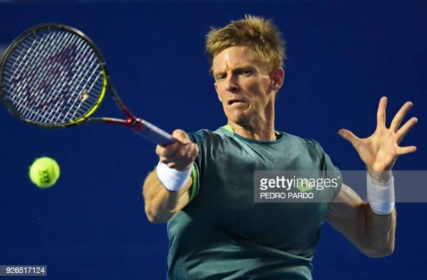 South African tennis player Kevin Anderson returns the ball to US player Jared Donaldson during their Mexico ATP 500 Open men's single semifinal...