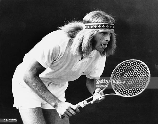 South African tennis player Raymond Moore competing against Ron Holmberg of the USA in the first round of the Wimbledon Men's Singles London 22nd...