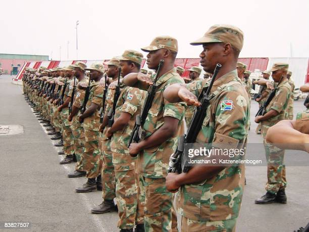 South African troops serving as peacekeepers with the African Union Mission in Burundi salute the arrival of Major General Siphiwe Nyanda chief of...