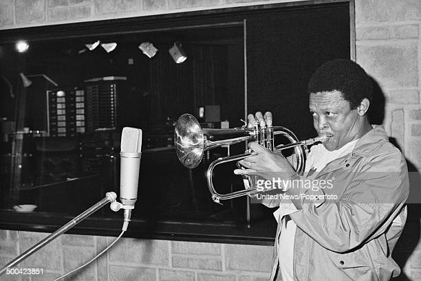 South African trumpet player Hugh Masekela pictured inside Zomba recording studios in Harlesden London on 9th August 1984