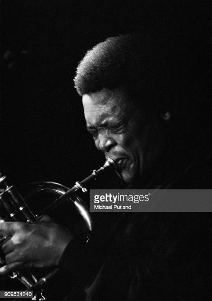 South African trumpeter singer and composer Hugh Masekela performs on stage in London 1989