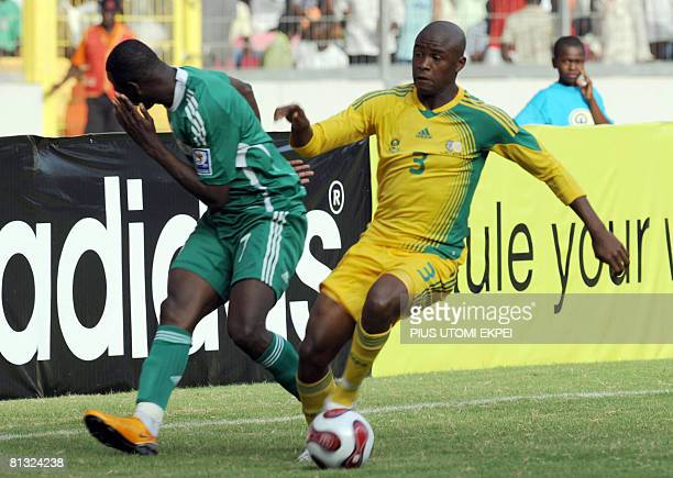 South African Tsepo Masilea collects the ball after hitting the face of Nigerian attacker John Utaka during FIFA 2010 World Cup and Africa Cup of...