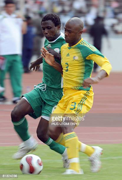 South African Tsepo Masilea struggles for ball possession with Nigeria's Mohammed Yusuf during FIFA 2010 World Cup and Africa Cup of Nations...