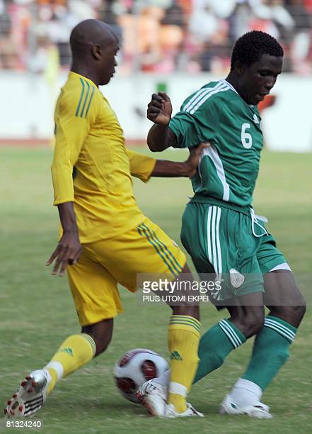 South African Tsepo Masilea tries to stop Nigeria's Mohammed Yusuf during FIFA 2010 World Cup and Africa Cup of Nations qualifying match in Abuja on...