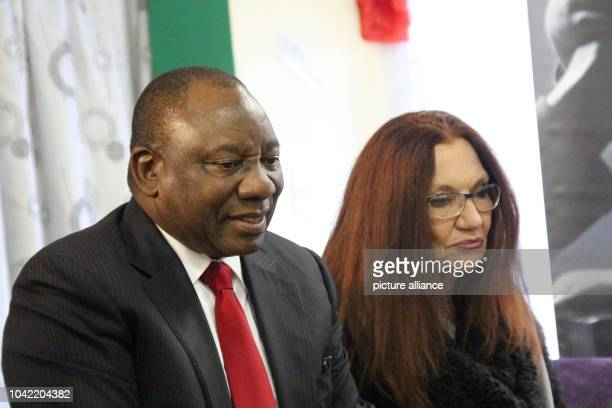 South African Vice President Cyril Ramaphosa with the care mother of the dead Nkosi Johnson Gail Johnson during a visit to the orphanage Nkosi's...