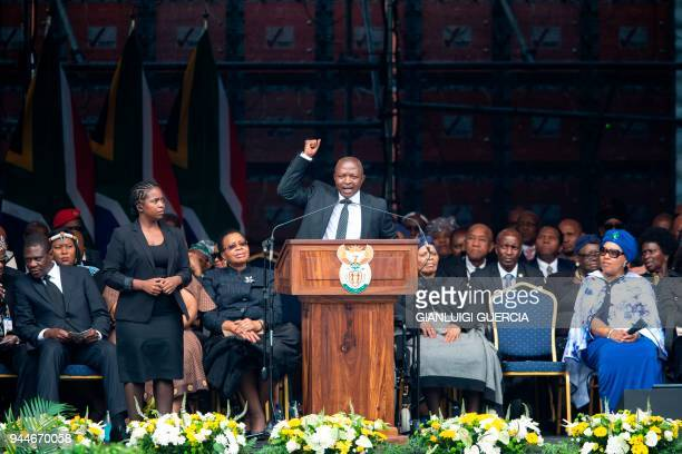 South African Vice President David Mabuza gestures at the Orlando Stadium in Soweto Johannesburg on April 11 2018 during a memorial service for late...