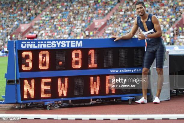 TOPSHOT South African Wayde van Niekerk reacts next to his world record result during the IAAF World Challenge Zlata Tretra athletics tournament in...