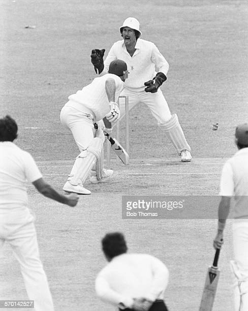 South African wicket keeper Ray Jennings appeals to the umpire as English batsman Geoff Boycott is caught by Adrian Kuiper at short leg off Alan...