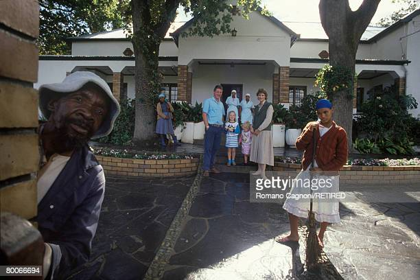 South African winegrower Paul de Villiers his wife Nelie and their children Angelique and Yolarsdie in front of their house with their gardeners and...