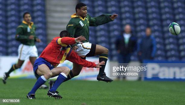 South African winger Kaya Malotana kicks the ball away from an unidentified Spanish player during their first round match in the world cup at...