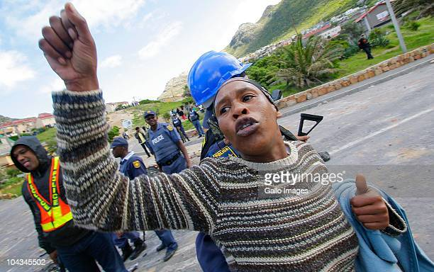 A South African woman reacts after violence broke out in Hout Bay near Cape Town South Africa on 21 September 2010 when community members clashed...