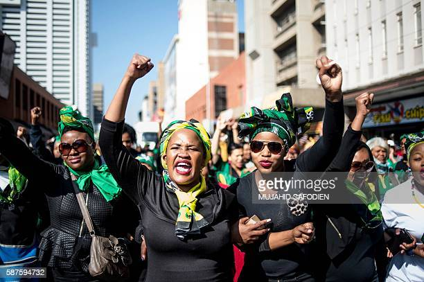 South African women march past the Women's Living Heritage Monument at Lilian Ngoyi Square as they move towards the Union Buildings in Pretoria on...