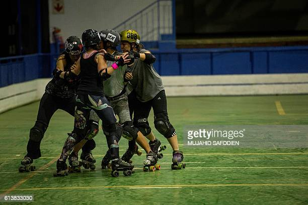 South African women practice Roller Derby during a training session on August 24 2016 in Johannesburg South African women are taking to roller derby...