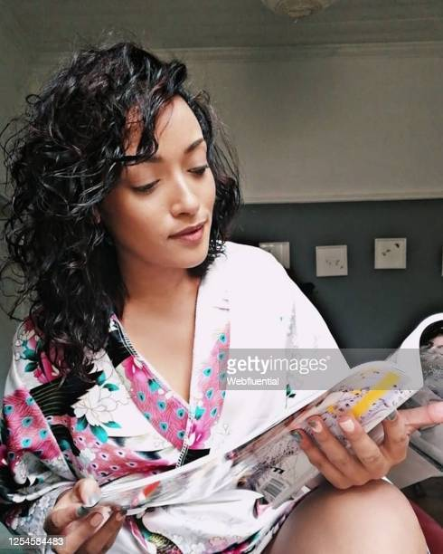 south african women reading a magazine during quarantine - webfluential stock pictures, royalty-free photos & images