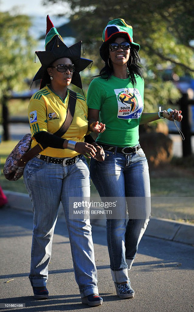 South African women walk at the airport of Nelspruit around the time of arrival of the Chilean national football team on June 6, 2010. Chile will play against Honduras in their first South Africa 2010 World Cup match on June 16. AFP PHOTO / Martin BERNETTI