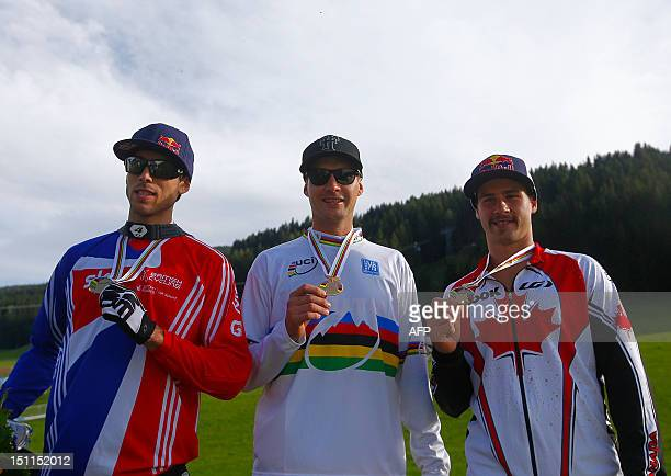 South African world champion Greg Minnaar Great Britain's Gee Atherton and Canada's Steve Smith poses with their medals after competing in the men's...