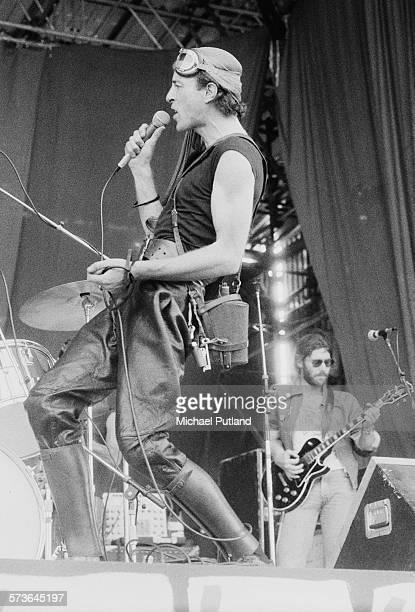 South African writer poet and musician Robert Calvert performing with English space rock group Hawkwind at Cardiff Castle Wales 24th July 1976