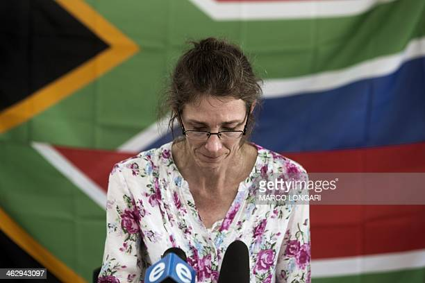 South African Yolande Korkie a former hostage and wife of Pierre Korkie pauses during a press conference in Johannesburg on January 16 2014 to appeal...