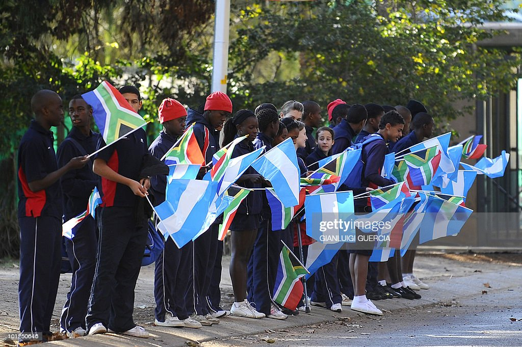 South African youth hold and wave South African and Argentinian flags as they wait for the arrival of the Argentinian football team on May 29, 2010 at the High Performance center at the University of Pretoria in Pretoria, South Africa. South Africa will host the FIFA World Cup from June 11th to July11th.