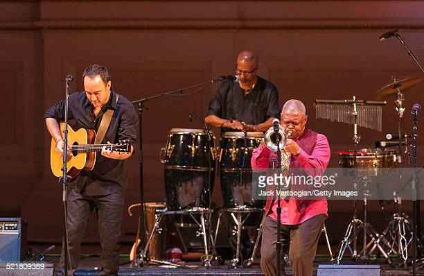 South Africanborn American musician Dave Matthews plays guitar as a special guest of composer bandleader and musician Hugh Masekela onstage at the...