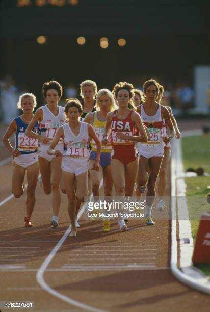 View of South Africanborn athlete Zola Budd competing for Great Britain and Mary Decker of the USA running in the women's 3000 metres final during...