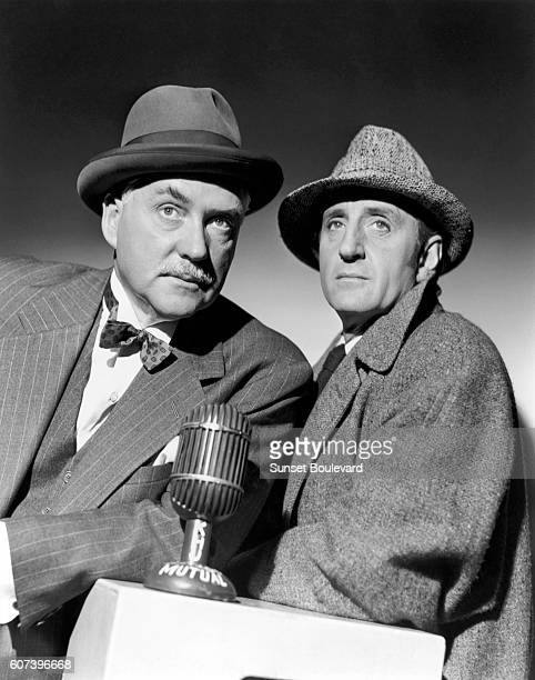 South Africanborn British actor Basil Rathbone and British actor Nigel Bruce on the set of The Adventures of Sherlock Holmes directed by Alfred L...