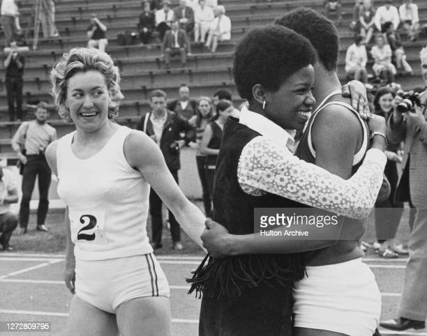 South Africanborn British runner Lillian Board congratulates the racewinner Jamaicanborn British runner Marilyn Neufville who is embraced by a...