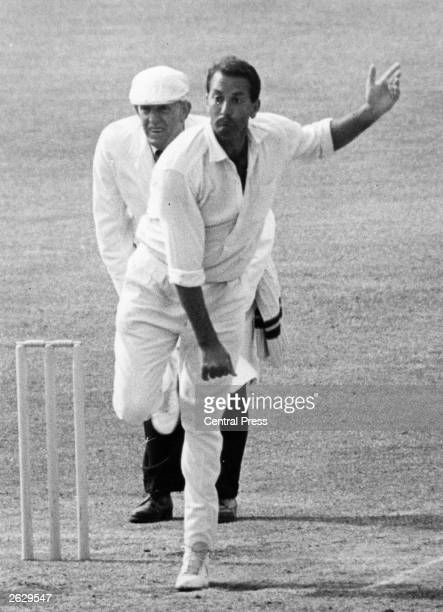 South Africanborn Worcestershire and England cricketer Basil D'Oliveira in action bowling Original Publication People Disc HU0279