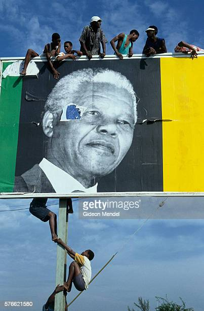 South Africans atop Nelson Mandela Campaign Billboard