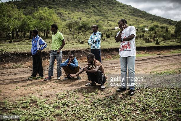 South Africans boys from rural areas in the KwaZulu Natal province wait on the road to be picked up by health workers working with Doctors Without...