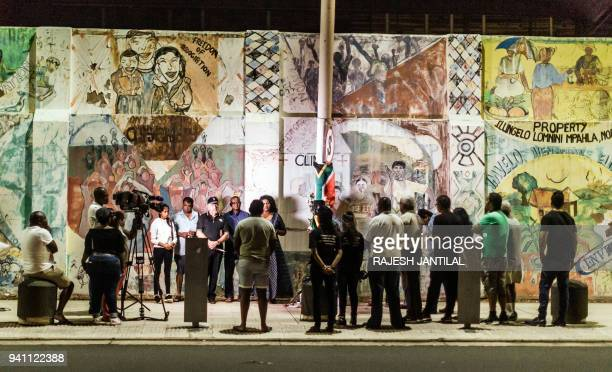 South Africans gather at the Old Durban Prison's Human Rights wall to pay their respects to the late South African highprofile antiapartheid activist...