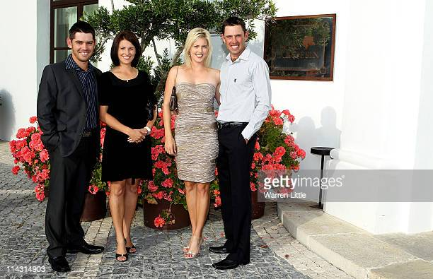 South Africans Louis Oosthuizen and Charl Schwartzel pose for a picture with their wives NelMare Oothuizen and Rosalind Schwartzel at the welcome...
