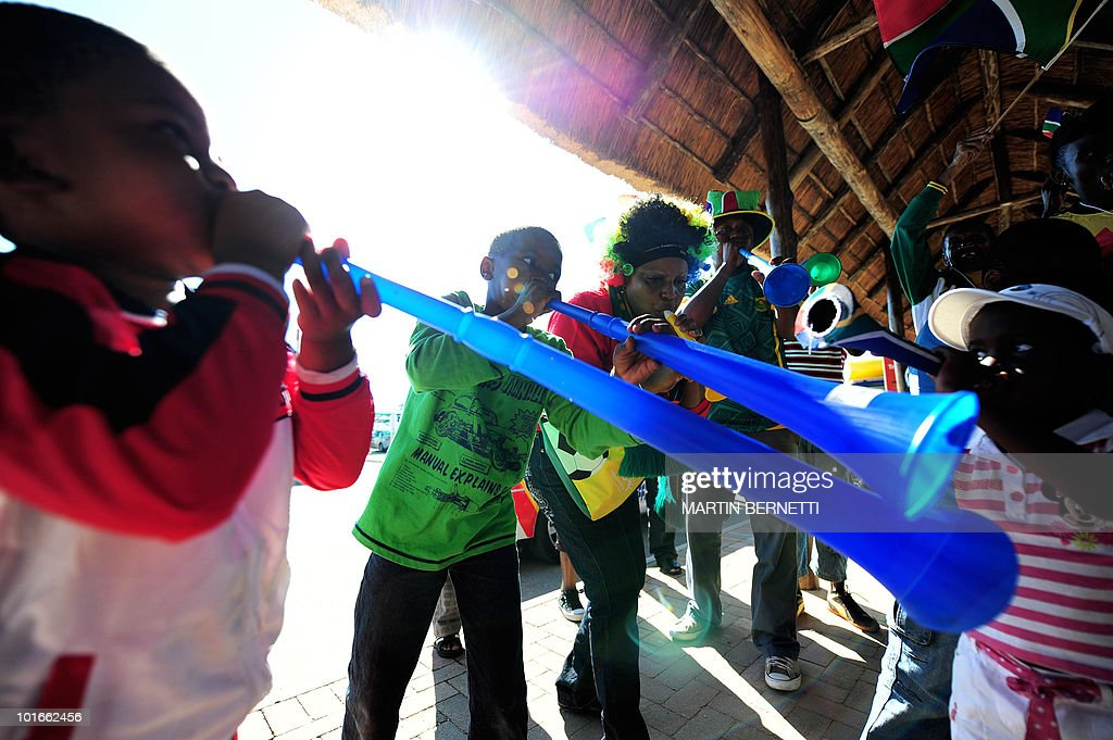 South Africans play vuvuzelas as they wait for the arrival of the Chilean national football team at the airport in Nelspruit on June 6, 2010. Chile will play against Honduras in their first South Africa 2010 World Cup match on June 16. AFP PHOTO / Martin BERNETTI
