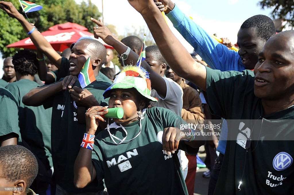 South Africans sing and dance on May 21, 2010 during the official celebration marking 20 days ahead of the FIFA WC2010 kick off at Vilakazi street in Soweto, South Africa. South Africa will host the FIFA World Cup from the 11 of June to the 11 of July, 2010.