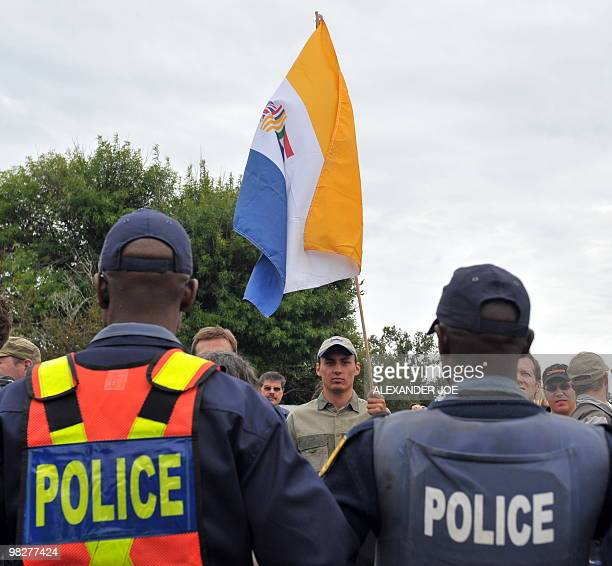 South Africans supporting the white supremacist Afrikaner Resistance Movement fly the apartheid era flag on April 6 2010 outside a South African...