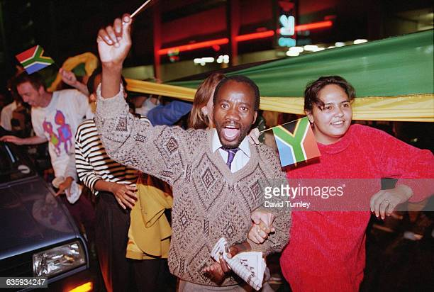 South Africans wave flags and celebrate Nelson Mandela's victory in the 1994 first allrace Presidential Election