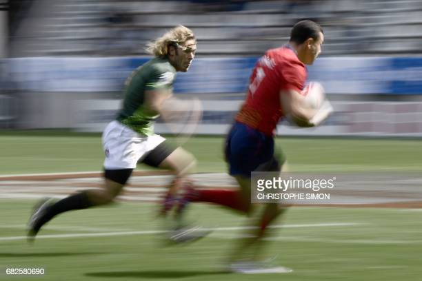 South African's Werner Kok vies with Scotland's Jamie Farndale during the Rugby 7 tournament rugby match South Africa versus Scotland on May 13 2017...