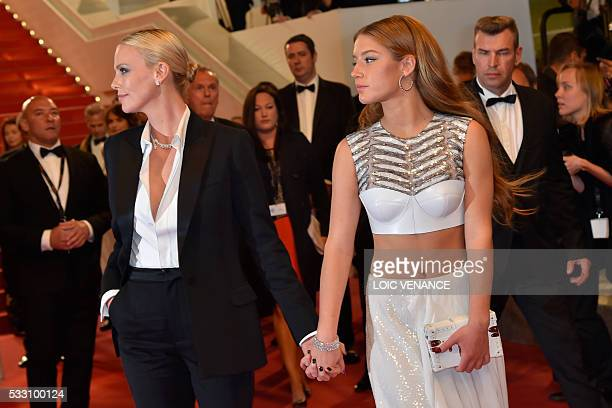 South AfricanUS actress Charlize Theron and French actress Adele Exarchopoulos leave on May 20 2016 the Festival Palace on May 20 2016 after the...