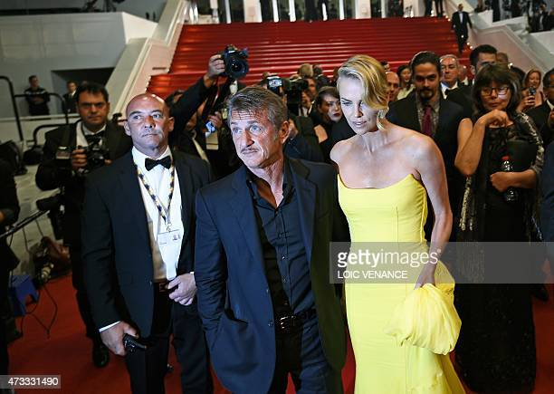 South AfricanUS actress Charlize Theron and her partner US actor Sean Penn leave the Festival palace after the the screening of the film 'Mad Max...