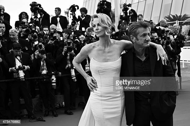 South AfricanUS actress Charlize Theron and her partner US actor Sean Penn pose as they arrive for the screening of the film 'Mad Max Fury Road'...